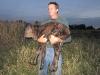 Brian carries the newborn calf to the barn.