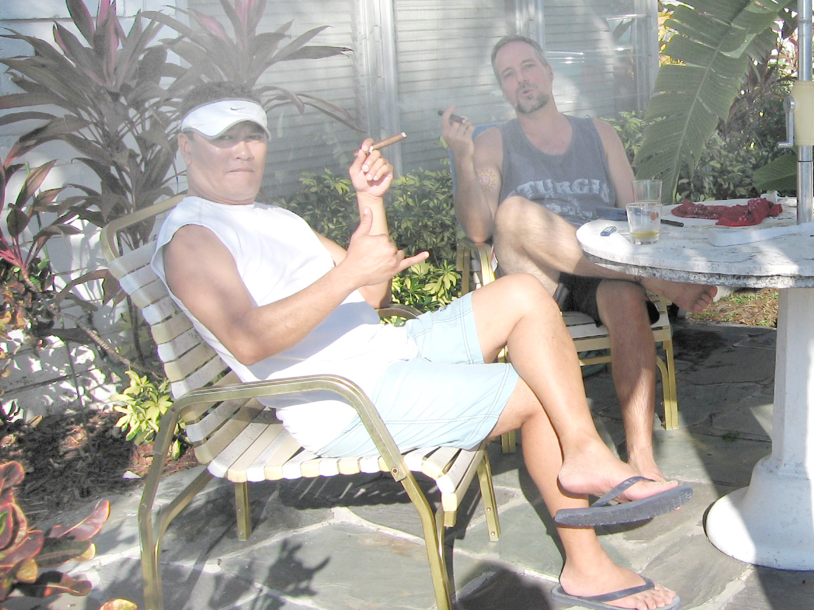 Mr. Gene Dulay and Jim enjoying Dominican cigars at the swingin' bachelor pad.
