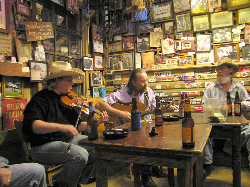 Dale Mayfield and friends pickin at the Luckenbach bar