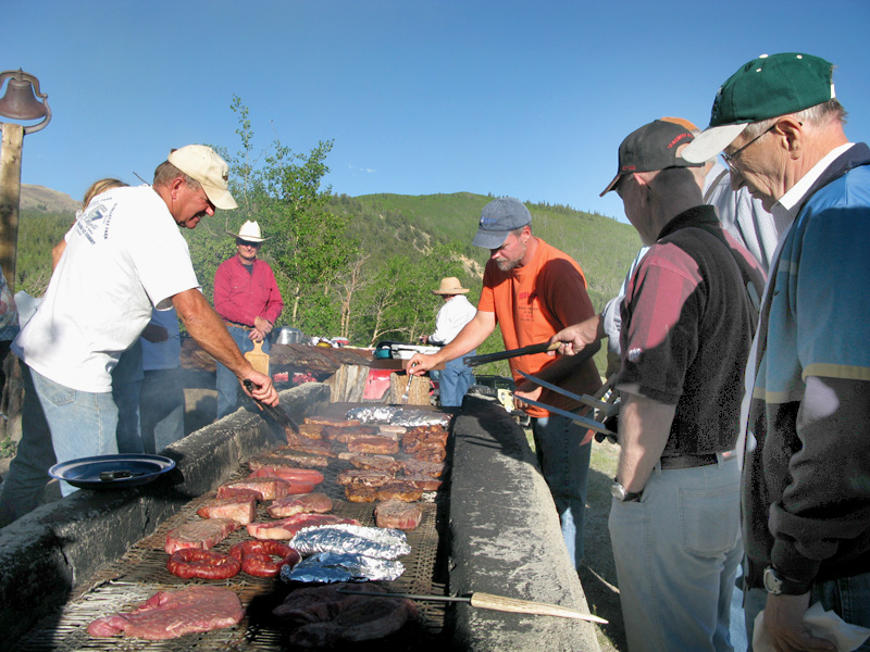 Jim and Jim work the grill at Vickers cookout on Gold Hill