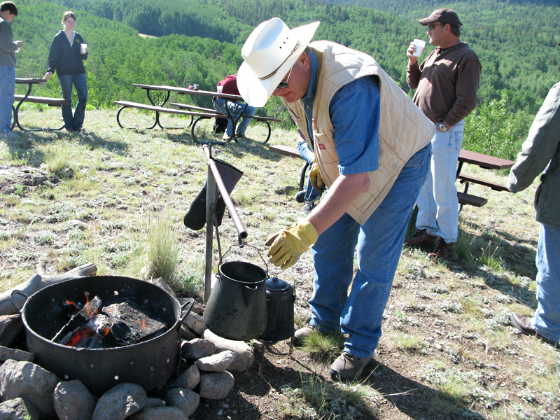 Larry serves up hot cowboy coffee at the Vickers Ranch Breakfast Ride