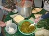 making homemade green chili and cheese tamales