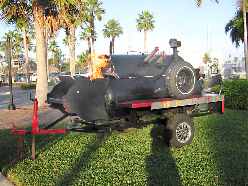19. Flaming pig roaster trailer for rent.