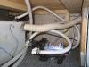 Realigned freshwater supply hose