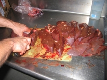 21. More butchering of a cow liver.