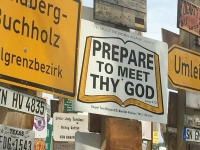 Meet Thy God at Signpost Forest, WatsonLake BC
