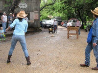 Cowgirl tries hat toss at Luckenbach festival