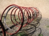 Bicycle rack made of recycled bike rims in T or C, NM