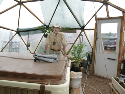 Sand Creek Realtor Duke in off Grid Greenhouse