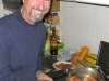 Sam cooks fresh wild Alaskan salmon he caught