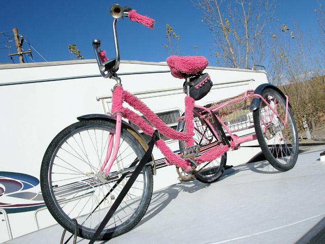 Fuzzy bike on Fernley, NV pop-up trailer at Desert Rose