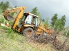Hauling felled tree with 4WD Case 580K backhoe