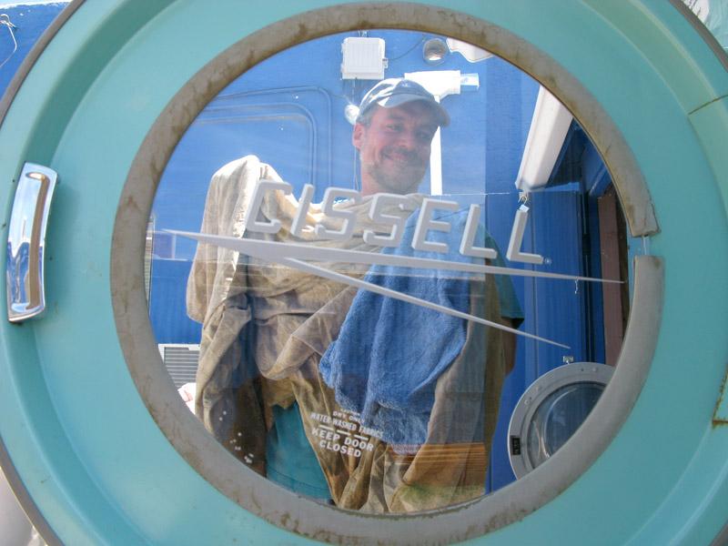 Laundryman Jim framed by Cissel commercial dryer door