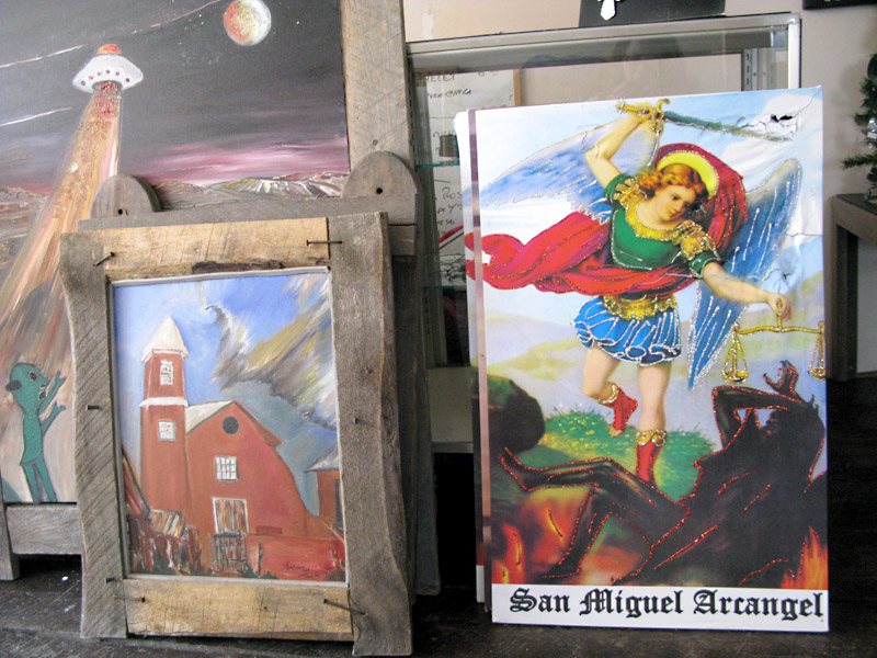 Art in the store of artist Charles Medina at El Santuario de Chimayo