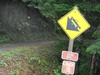 steep grade road sign rogue river forest oregon
