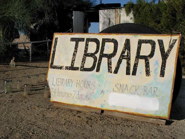 Slab City Lizard Tree Library Sign