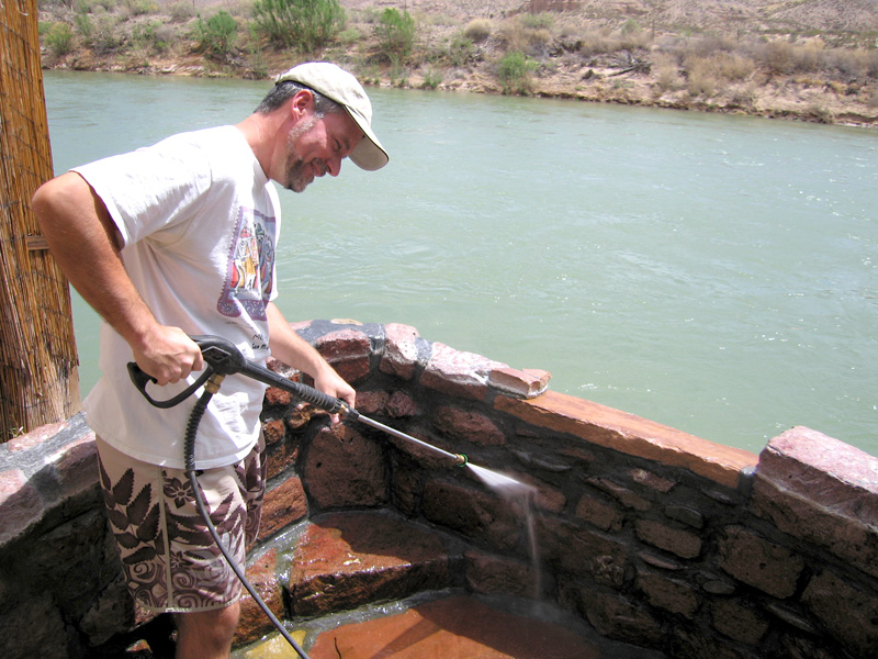 Jim power-washes hot mineral bath tubs at Riverbend Hot Springs
