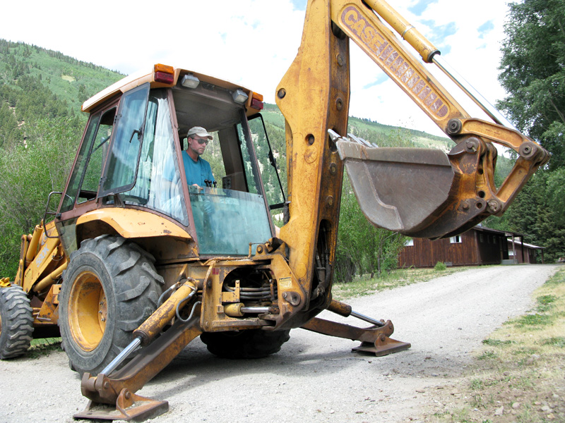 Jim plants signposts with backhoe