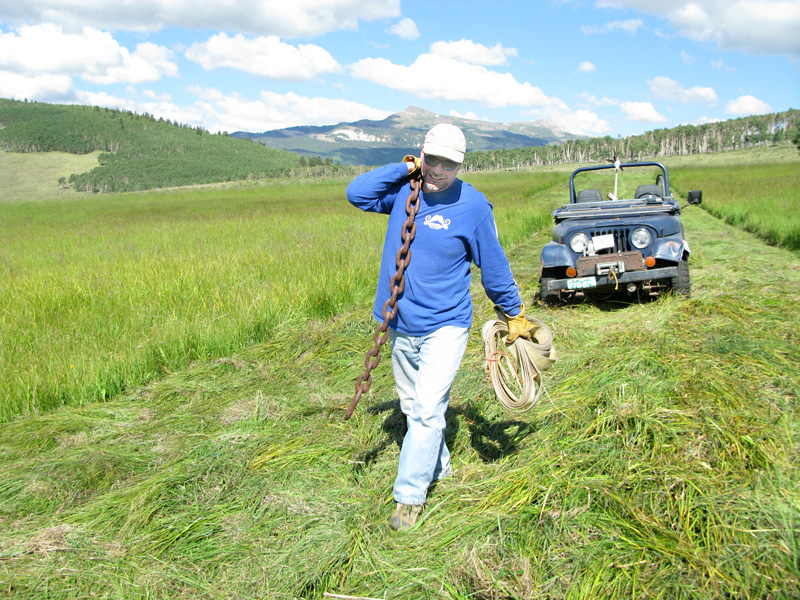 Working on the chain gang in the Vickers Ranch hay field