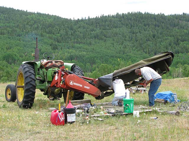 Jim helps replace blades on Vickers Ranch mower