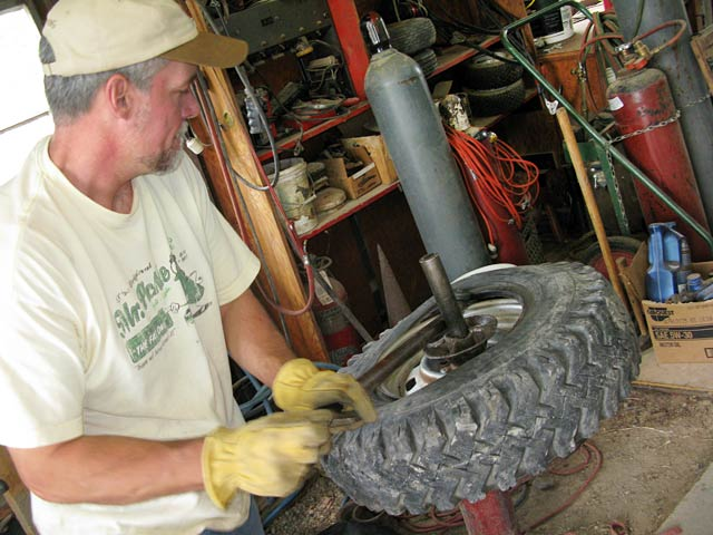 Jim repairs Jeep tire workamping at Vickers Ranch