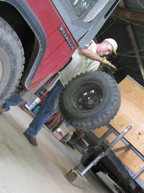 Jim bounces tire he fixed.