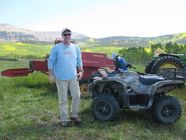 Jim working hay fields at Vickers Ranch