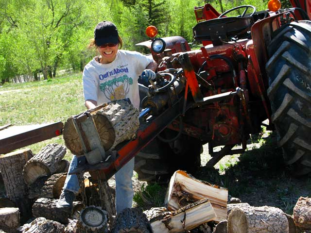 Rene splitting logs workamping at Vickers Guest Ranch