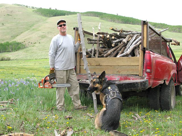 Wyatt and Jim collecting wood for Vickers Ranch