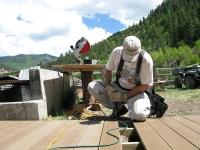 Jim building new deck behind Vickers Ranch rec hall