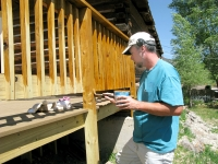 Jim painting the new deck behind Vickers Ranch rec hall