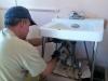Jim Repairs Sink Workamping at Vickers Ranch