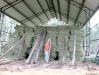 Jim stacks hay bales in the vickers hay Barn